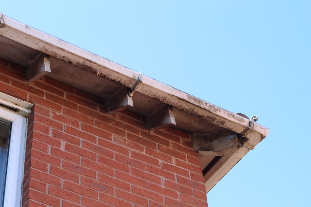 Dirty Old Guttering On House